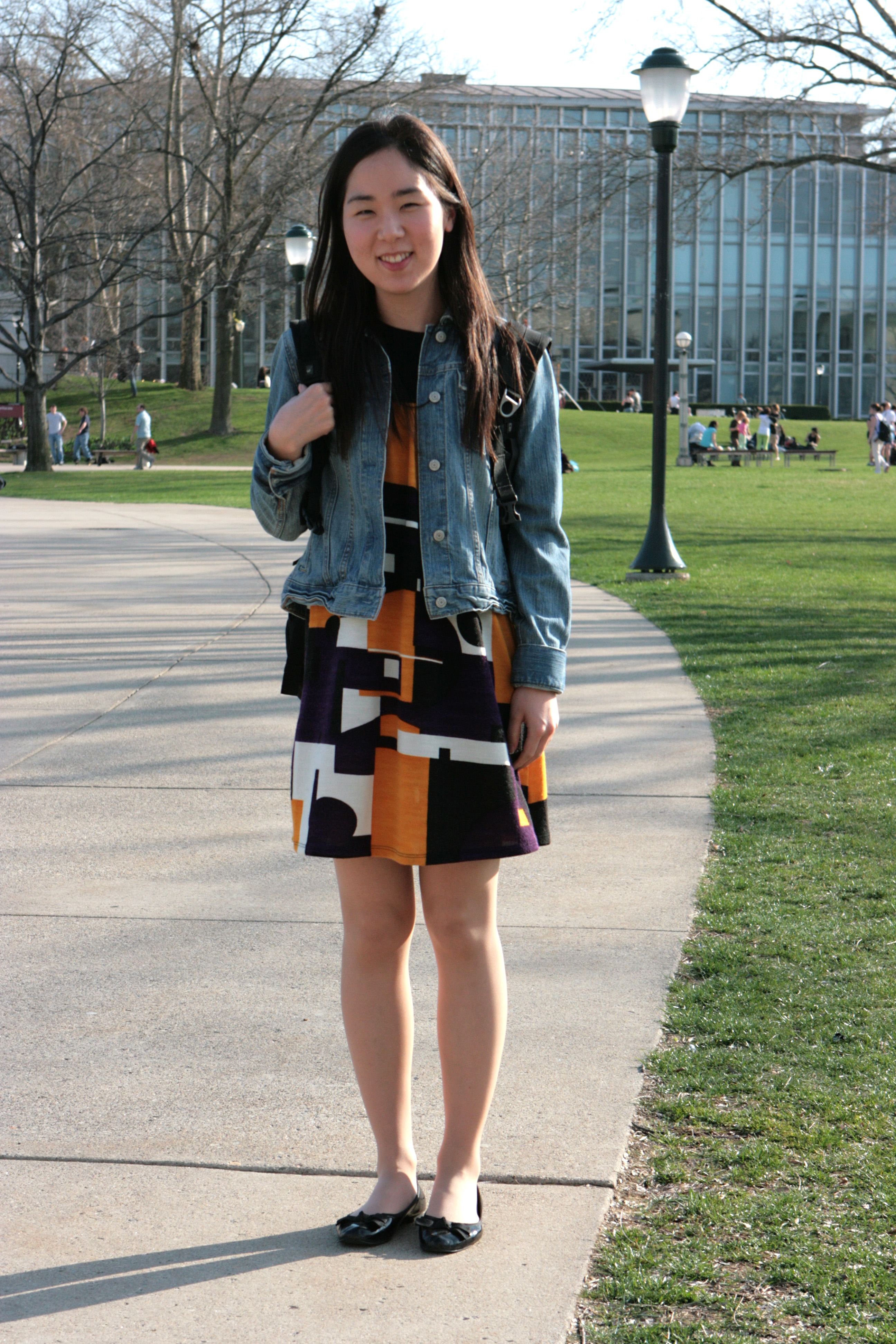 Lee stylishly pairs together a bright dress and a classic denim jacket. (credit: Courtesy of Eddie Wong)