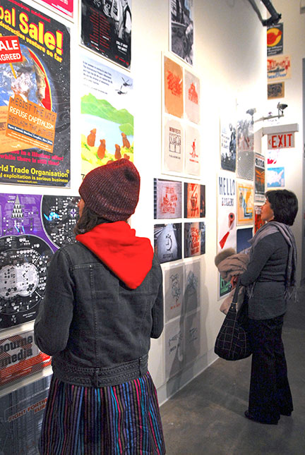 The exhibit displays numerous posters that have been instrumental in inciting social and cultural revolutions through the years. (credit: Myyk Seok | Photo Staff)