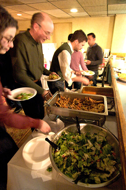The event included an all-vegan buffet, featuring bread, hummus, veggies. 