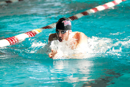 Junior Jason Huber helps the Tartans take the first place finish in the 200-yard medley relay Saturday (credit: Glenn Stroz/Photo Staff)