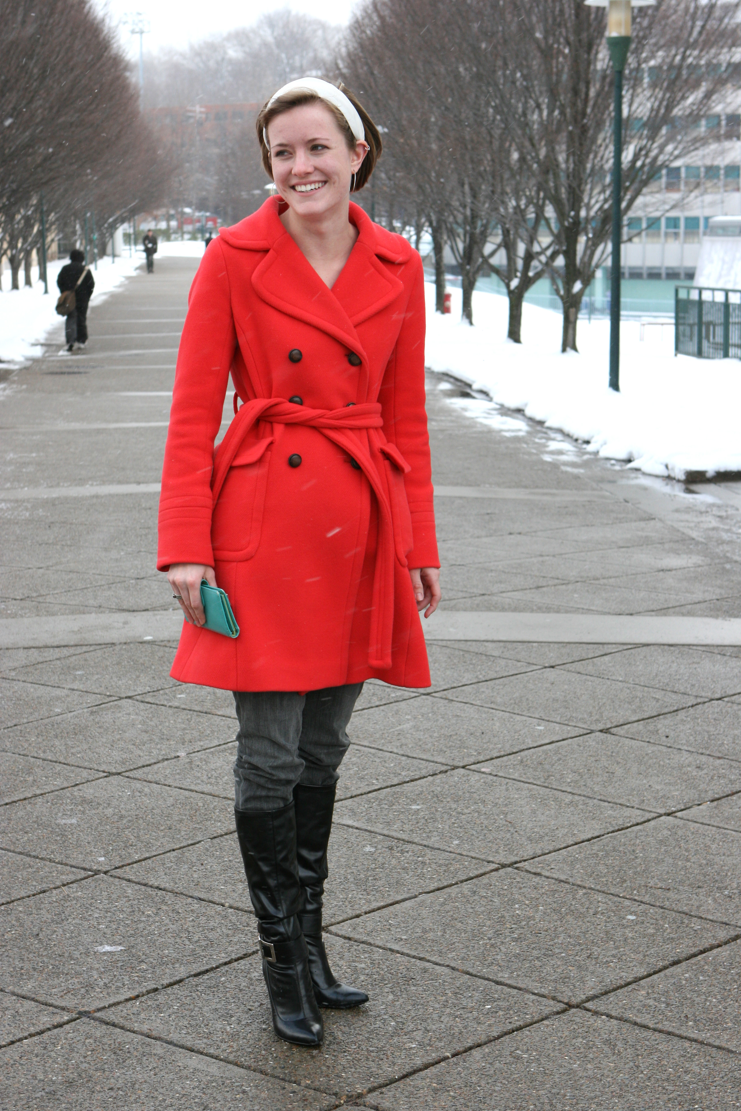 Karen Branick adds a flash of color to her look by wearing a bright orange winter coat.