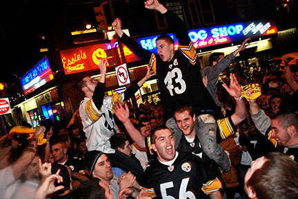 Citizens and college students in Pittsburgh riot in the streets after the Steelers win their sixth Super Bowl. (credit: J.W. Ramp/Publisher)