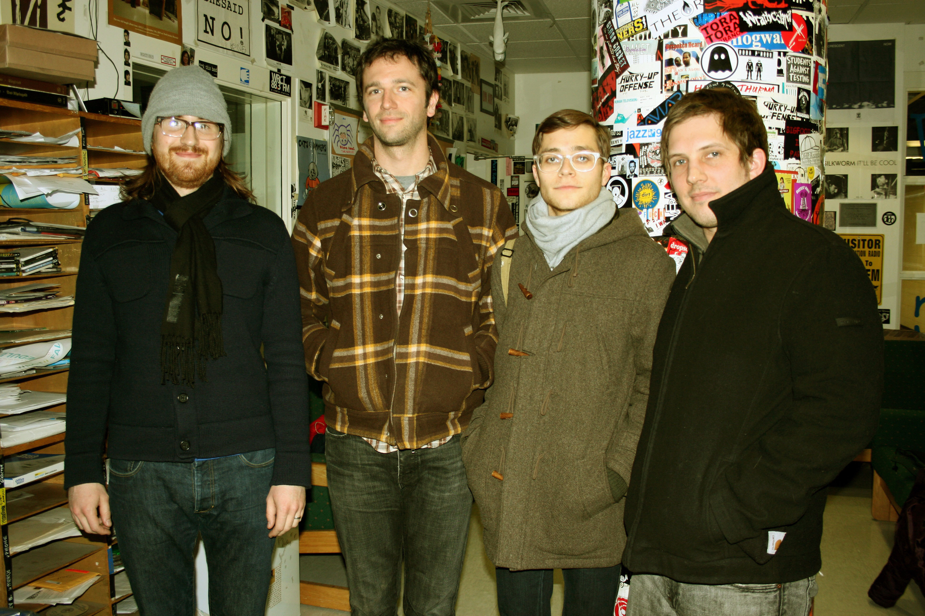 Tapes 'n Tapes members (from left) Josh Grier, Erik Appelwick, Jeremy Hanson, and Matt Kretzman pose in the WRCT's studio. (credit: Courtesy of M. Callen)