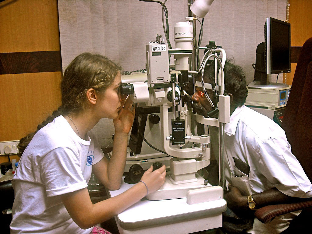 Junior science and humanities scholar, Ashley Kilp, works with Unite for Sight to help correct a man's vision. (credit: Courtesy of Ashley Kilp)