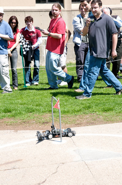 Onlookers watch on as a Mobot races through one of the gates during the 15th annual Mobot races last Friday.