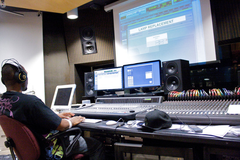 Senior Derrick Walker works in one of the music studios in CFA's basement, where high school students learn basic technology skills. (credit: Travis Wolfe/Photo Staff)