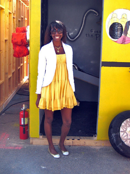 Jonnelle Saunders puts together a feminine look with a ruffled, yellow frock and crisp jacket. (credit: Courtesy of Eddie Wong)