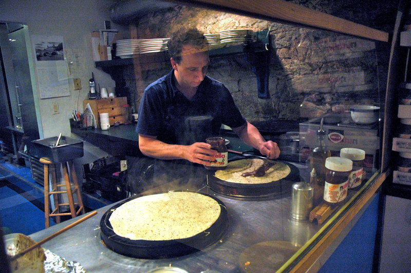 Handler cooks delectable crêpes at the Shadyside branch. (credit: Celia Ludwinksi | Assistant Photo Editor)