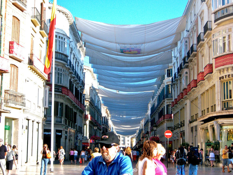 Wide sheets stretch across rooftops, protecting passers by from the harsh rays of the sun. Spanish culture proved to be a refreshing change from the ordinary for the writer. (credit: Sabrina Porter | Personnel Manager)