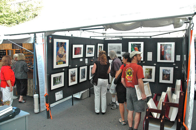 Vistors glance at the artists' work avidly, some just browsing while others shopping for pictures. (credit: Jesse Kummer | Photo Staff)