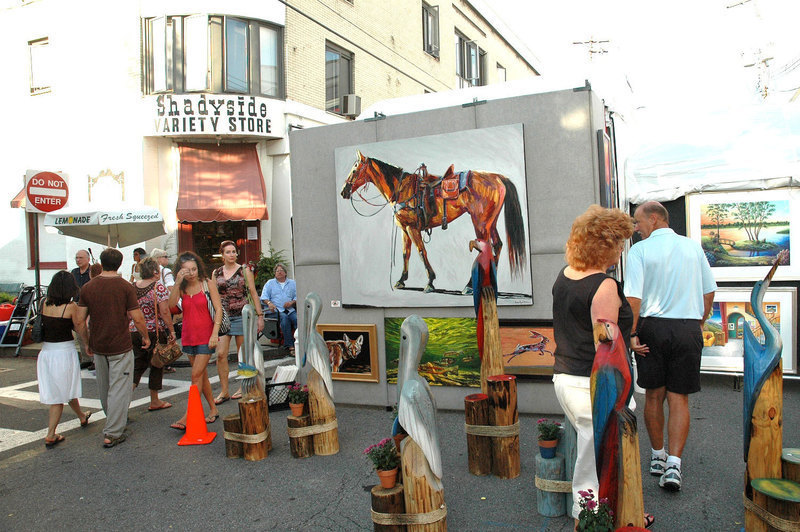 An artist displays his or her work in the middle of the street. (credit: Jesse Kummer | Photo Staff)