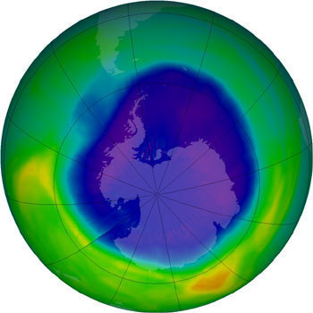 "Above is an image produced from one of NASA's satellites that monitors ozone thickness over the earth. The purple portion of the figure shows the ozone ""hole"" over Antarctica.  (credit: Courtesy of NASA)"