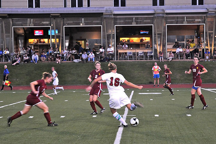 Senior Casey Garth maneuvers the ball past a Denison defender. The Tartans  ultimately lost 1–0.