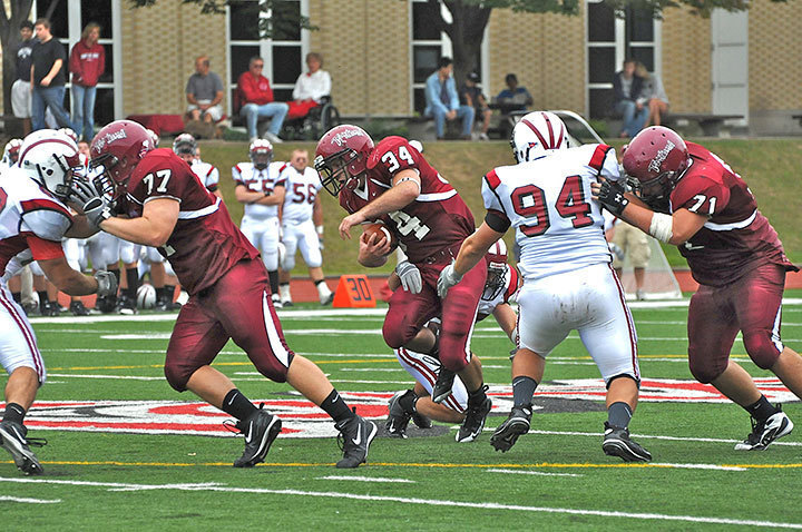 Junior fullback Justin Pratt carries the ball during Saturday's football game versus Grove City. (credit: Tommy Hofman)