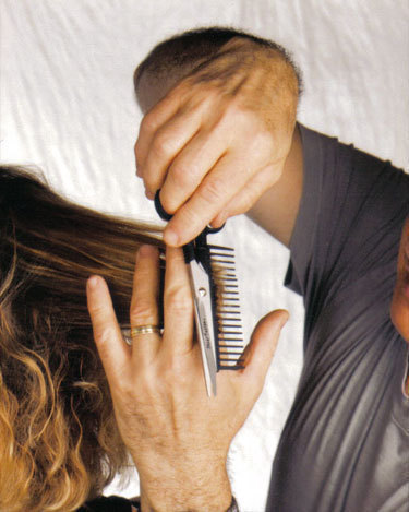 Enrico Bellisario, a hair stylist in Oakland, uses Shearfuzion to style hair. Shearfuzion helps hair stylists cut hair with ease and helps reduce the symptoms of carpal tunnel syndrome.  (credit: Courtesy of David Huang)