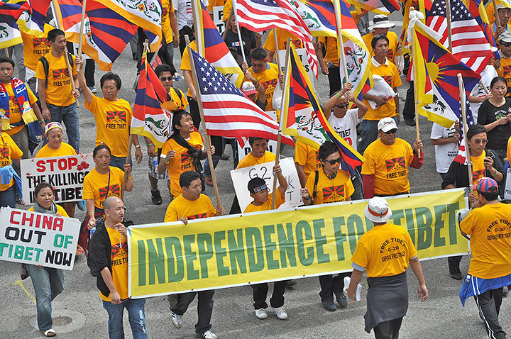 Protesters marched the streets, rallying  to free Tibet.  (credit: j.w. Ramp/Publisher)