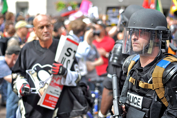Police officers, dressed in riot gear, lined the streets of downtown Pittsburgh. (credit: j.w. Ramp/Publisher)