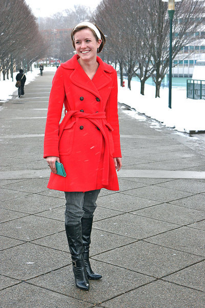Karen Branick's poppy red coat adds a flash of color to her outfit. (credit: Eddie Wong)
