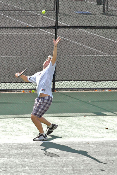 Junior Alex Nemerov intensely sets up for a serve during his match. (credit: Devin Beahm)