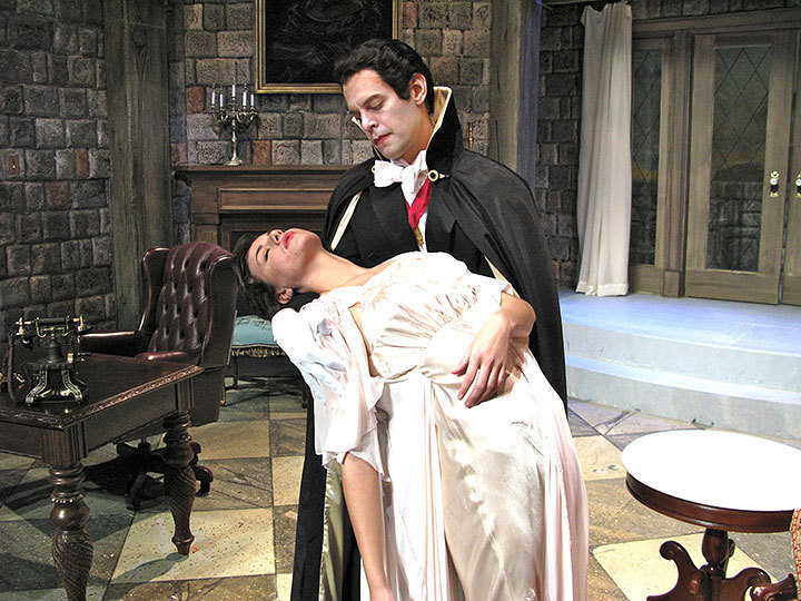 Count Dracula prepares to quench his thirst by sucking the blood of Mina, who lies hypnotized in his arms. (credit: Courtesy of F.J. Hartland)