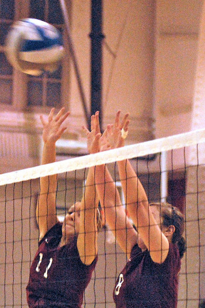 Sophomore Madeline Rosnick and senior Megan Killeen attempt to block a ball hit from Washington University's players.