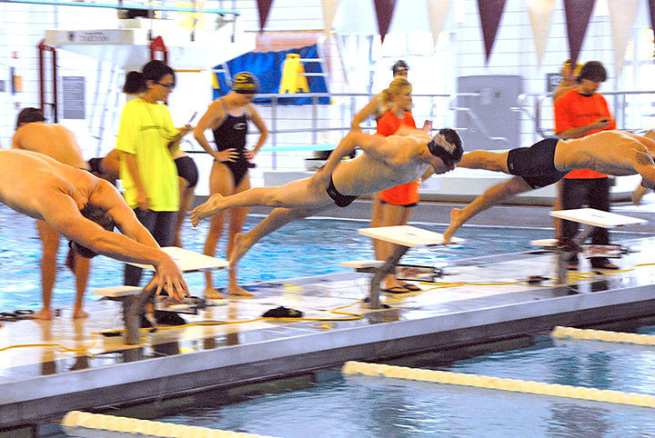 A Tartan swimmer shoots off the starting block in the first home meet against DII Clairon University at home. Despite a 181–117 loss, the Tartans took three of the five events.