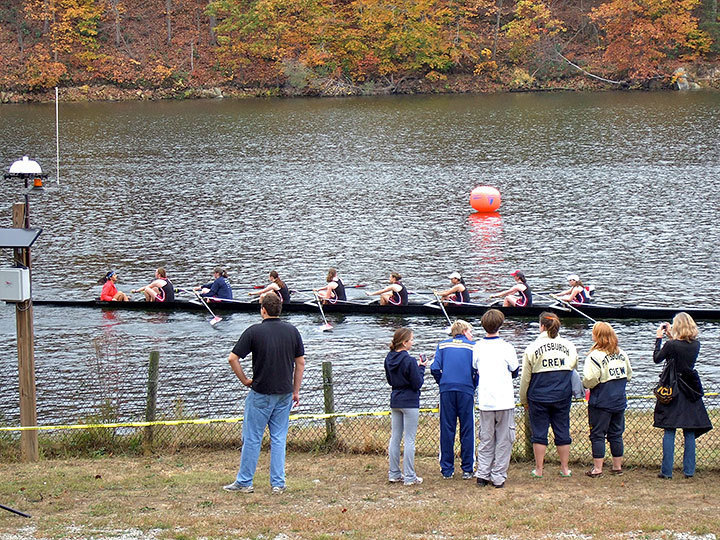 The women's crew team races along the Occoquan River in Virginia, against twenty five east coast schools. This meet concludes their fall season and the crew teams will now begin winter training. Photo courtesy of Harold Kim.