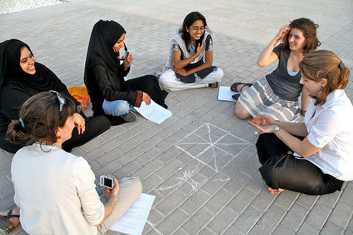 Students from Doha and Pittsburgh learn traditional Qatari games. (credit: Patrick Gage Kelley)