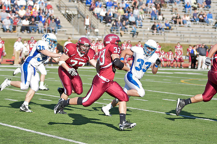 Senior running back Andrew Lovrovich pushes towards the Spartans' endzone. The Tartans ended up losing 17–34. (credit: Travis Wolfe/Photo Staff)