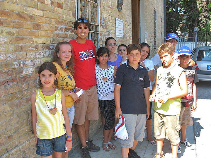 The writer with campers in Roseto degli Abruzzi, outside the school where the camp was held. (credit: Courtesy of Robert Houle)