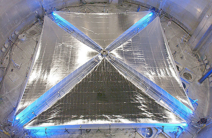 Pictured is a solar sail inside a vacuum chamber, which will be tested to see if it can withstand the conditions of outer space. Solar sails will use the energy from photons of light to propel spacecraft. (credit: Courtesy of www.nasa.gov)