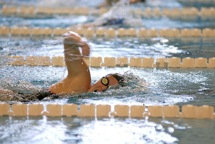 Sophomore Christina Swierkocki competes in the 200 freestyle for the Tartans in the University Center, where she swam a season-best 2:03.55. The Tartans triumphed over Rochester 167–90, and W&L 165–92
