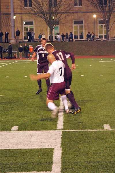 Senior Pat Lutz contests the ball with a Knight opponent. The Sweet 16 match brought out record attendance and support for the Tartans, who this season qualified for the round for the first time in history.