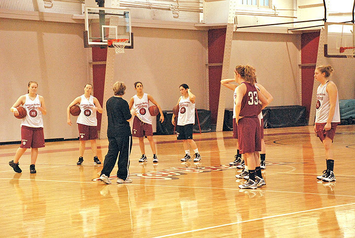 The Carnegie Mellon women's basketball team circles around their coach, Gerri Seidl. The Tartans are currently 8–6 for the season and 1–2 for UAA play.