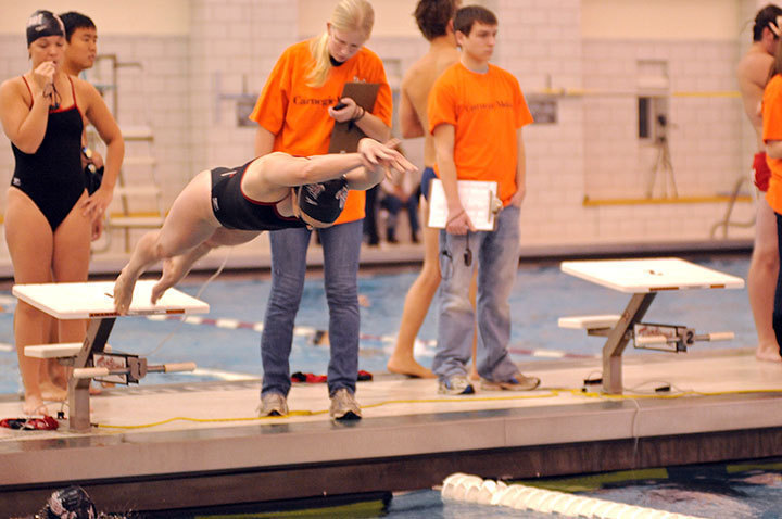 Sophomore Lisa Brubaker flies off the starting block in the 200-yard medley relay, where she swam the butterfly leg of the race. Brubaker also competed in three other events during the meet.