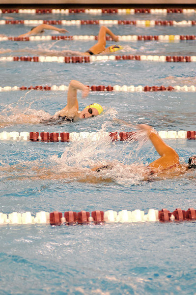 A Tartan swimmer tries to maintain a lead over an Allegheny competitor in Friday's home meet during the 1000-yard freestyle. The Tartans topped the Gators by a good margin, 162–124.