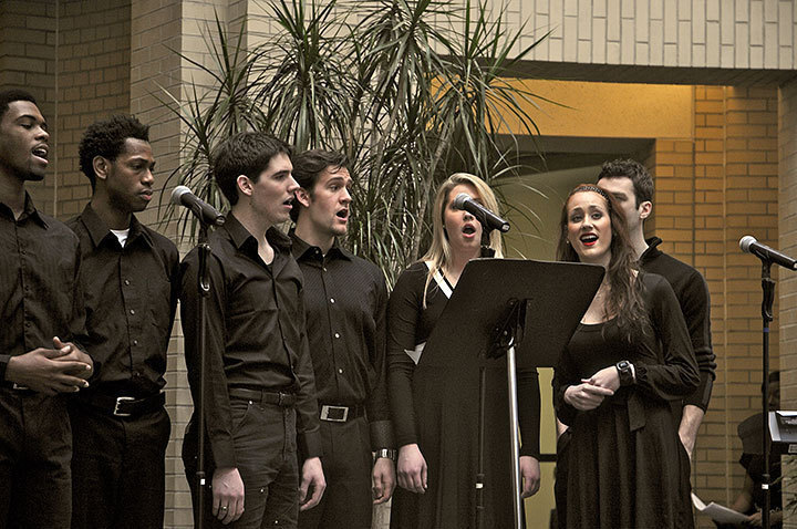 """Students from the Schools of Drama and Music begin the """"Community and Choral Tribute"""" in Kirr Commons with a group vocal performance. (credit: Celia Ludwinski)"""