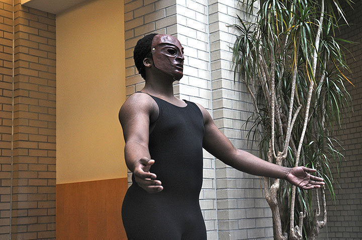 """Students from the Schools of Music and Drama put on a short production honoring Dr. Martin Luther King, Jr. in a series of performances. Here, a student performed an interpretive dance to dramatic reading of """"A Dream Deferred"""" by Langston Hughes. (credit: Celia Ludwinski)"""