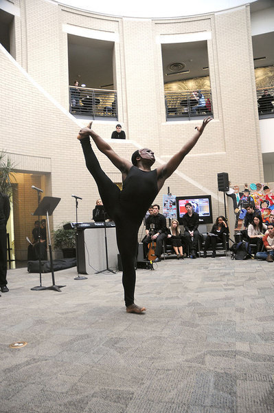 """A student from the School of Drama performs an interpretive dance accompanied by a reading of """"A Dream Deferred"""" by Langston Hughes. (credit: Celia Ludwinski)"""