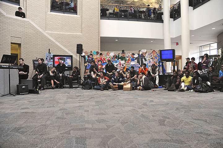 """A crowd of students and faculty gather to watch a """"Community and Choral Tribute"""" in Kirr Commons, presented by students from the Schools of Music and Drama."""