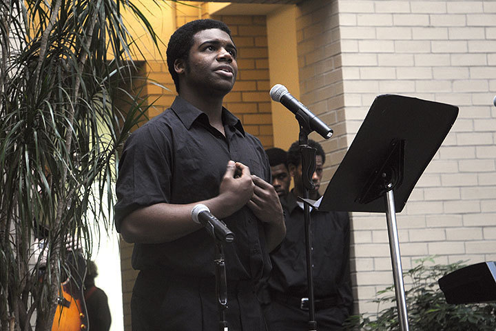 """A student performs a dramatic reading of Maya Angelou's """"Million Man March."""" (credit: Celia Ludwinski)"""