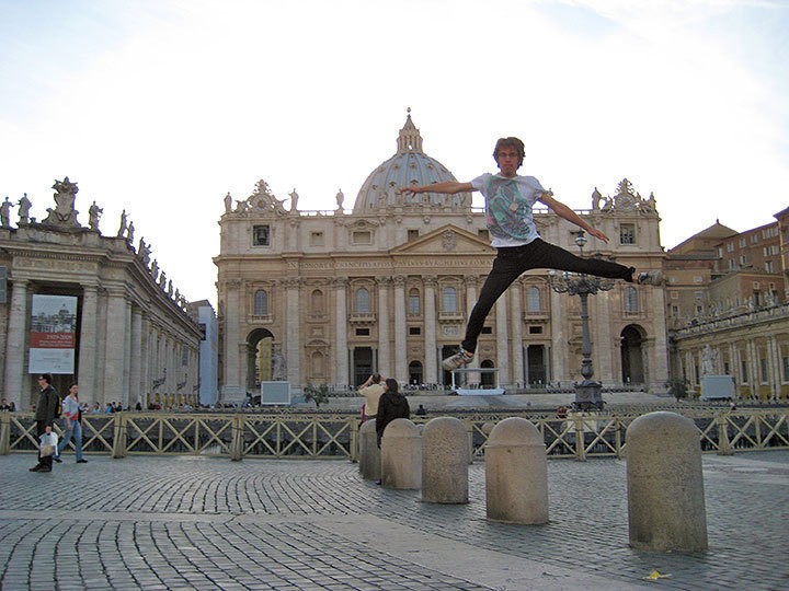 Robert Wiegmann jumping in front of Saint Peter's Basillica. (credit: Courtesy of Robert Wiegmann and Kelly Phouyaphone)