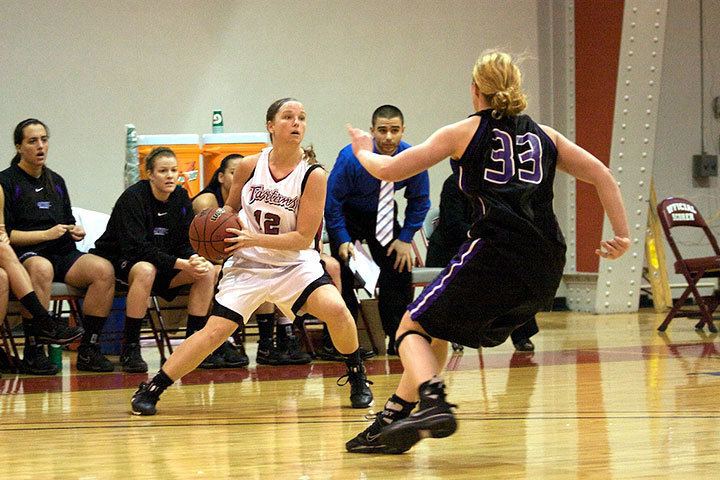 Junior Jessica Buranovsky looks for an opening to pass the ball. The Tartans fell to New York University 52–66.  (credit: Travis Wolfe/Photo Staff )
