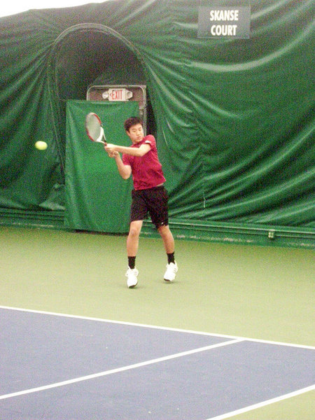 Sophomore Jeremy King  hits a backhand during the ITA Indoor Championships.  (credit: Courtesy of Andrew Girard)