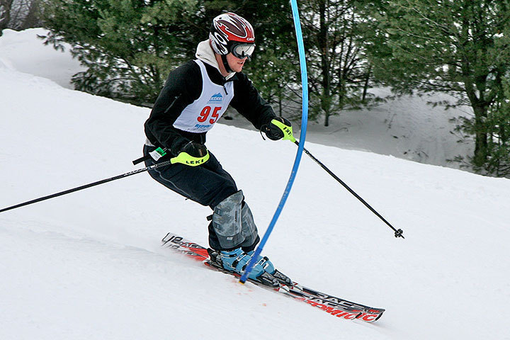 Senior Evan Gates maneuvers his way down the slope. This is the second year the alpine ski team has qualified for regional competition.  (credit: Courtesy of Beth Passmore)