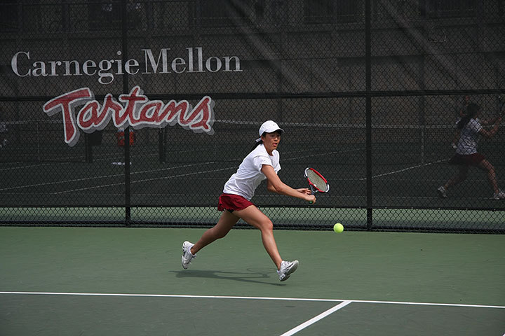 Sophomore Cze-Ja Tam runs to slice a backhand against number-16 Mary Washington. Tam helped contribute two points by winning both her singles and doubles quite easily.  (credit: Travis Wolfe/Photo Staff )