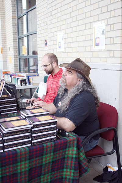 Marinelli signs copies of  his book, The Comet and the Tornado. (credit: Celia Ludwinski/Photo Editor)