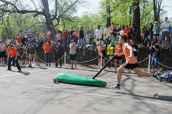 A member of the men's SDC D team pushes a buggy up Hill 5 on Friday. (credit: Kristen Severson/Publisher)