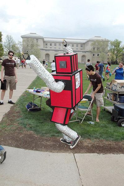 The Robotics Club mascot dances and cheers on race contestants.  (credit: Isaac Jones| Comics Editor)