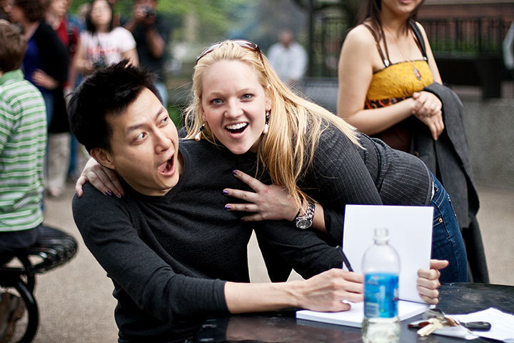A visiting student from Penn State embraces Jorge Cham, the author of PhD comics, at his book signing. (credit: Patrick Gage Kelley/Contributing Editor)